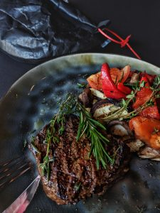 Steak and red peppers.