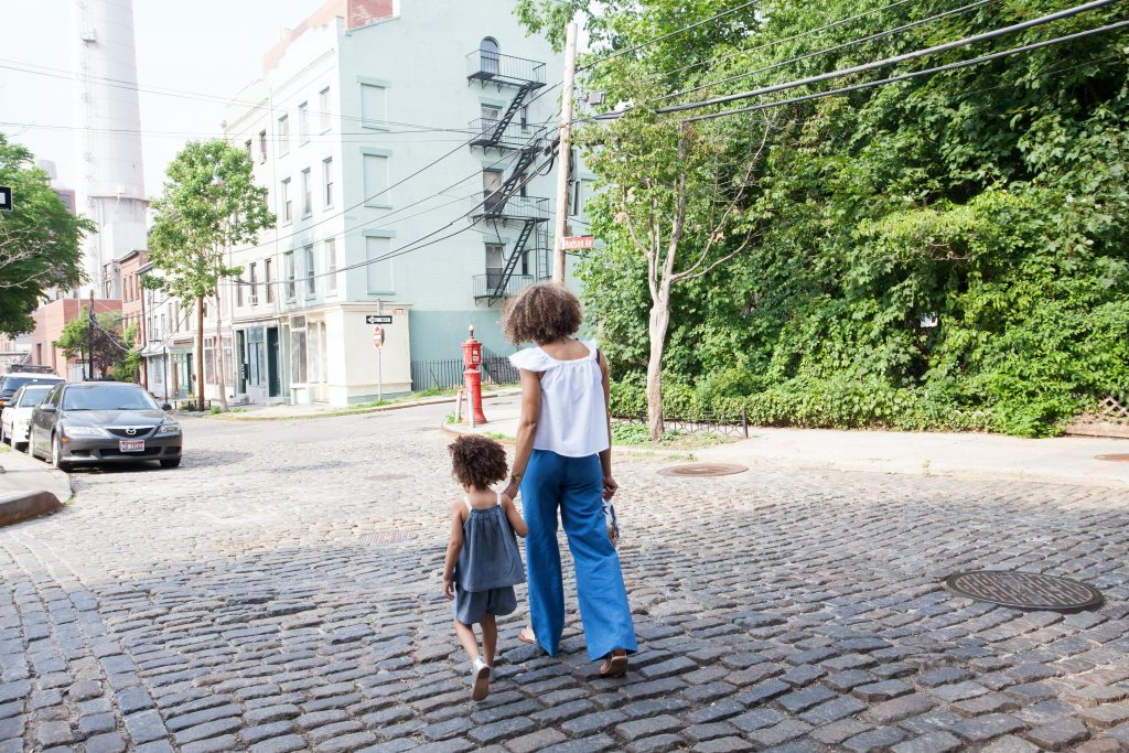 Woman and child walking.