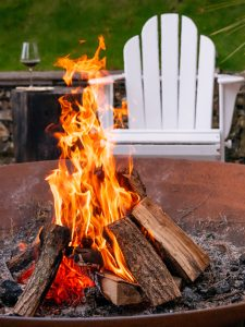 White chair by a fire pit.