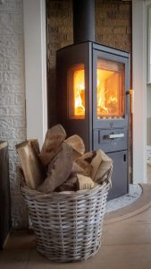 Wood by burning stove.