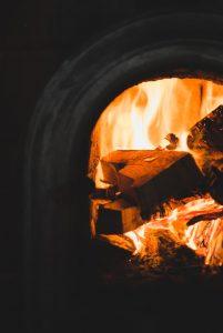 Burning wood inside stove.