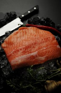 Salmon with knife.