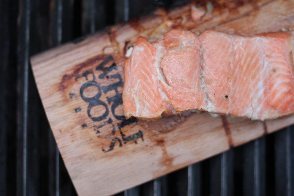 Chopped salmon on chopping board.