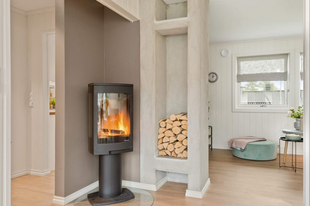 Stove in stylish white room.