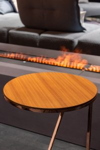 Table by fireplace.