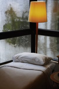 White bed by window.