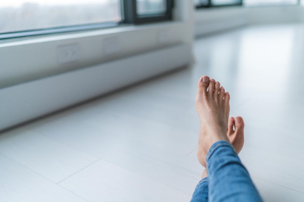 Feet by heater.