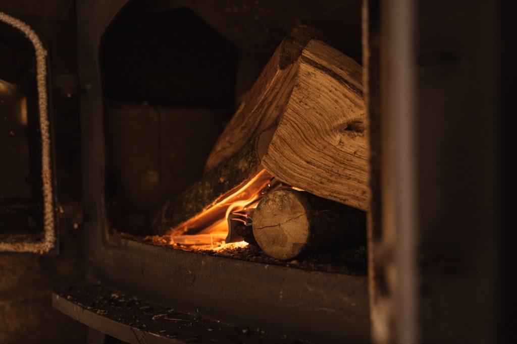 Stove with lit wood.