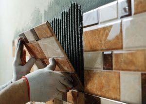 Putting up tiles.