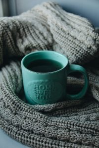 Home sweet home cup and textile.